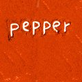 Pepper abstract background made of powder with text Stock Image