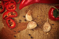 Pepper and garlic as hot food ingredients for piquant cuisine red chili spice organic on wooden kitchen plate spicy Royalty Free Stock Photography