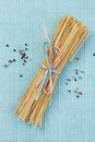 Pepper linguine tied with pastel colored straw ribbons with mixed peppercorns Stock Photography