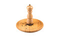 Pepper mill and black peppercorn on wooden board Royalty Free Stock Image
