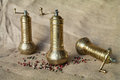 Pepper mills metallic with colored peppercorns Stock Images