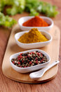 Pepper and other spices in the bowl Stock Images