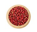 Pepper red peppercorns in wooden dish.