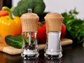 Pepper and salt mills on kitchen table Stock Photos