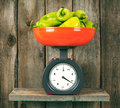 Pepper on scales Royalty Free Stock Photo