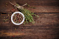 Pepper and thyme on wooden board Stock Images