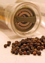 Peppercorns and grinder mill photo sepia of ideal for food ingredients etc Royalty Free Stock Photo