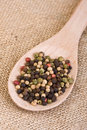Peppercorns on Wooden Spoon Stock Photos