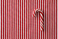 Peppermint candy cane on striped background a textile Royalty Free Stock Photography