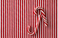 Peppermint candy canes on striped background a textile Stock Photography