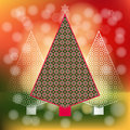 Peppermint candy christmas trees funky and unique in a row pattern diffused background Royalty Free Stock Photo