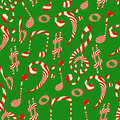 Peppermint candy finish of music symbols. Seamless pattern on green background.
