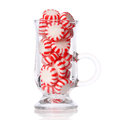 Peppermint candy in glass isolated on white. Red striped mint Christmas candy Royalty Free Stock Photo