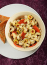 Pepperoni pasta and garlic bread at restaurant Royalty Free Stock Photos