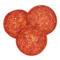 Pepperoni pieces slices isolated on white with path shot from above Stock Images