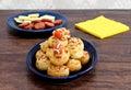 Pepperoni pinwheel snacks garnished with footballs. Royalty Free Stock Photo
