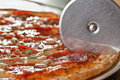 Pepperoni pizza cutter Royalty Free Stock Photo