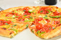 Pepperoni pizza with green peppers and sundried tomatoes Stock Photography