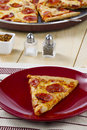 Pepperoni pizza with salt and pepper Royalty Free Stock Photo