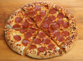 Pepperoni pizza with stuffed crust salami a suce filled Royalty Free Stock Photos