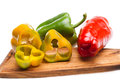 Peppers On Chopping Board Stock Photos