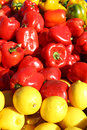 Peppers and lemons at farmer s market a pile of bright red yellow outside for sale Stock Photo