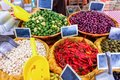 Peppers, olives and French beans in a market Royalty Free Stock Photo