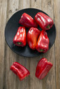 Peppers on a rustic wooden table Royalty Free Stock Photos