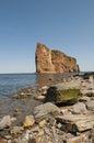 Perce rock background shoreline foreground Royalty Free Stock Photos