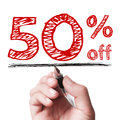 Percent off hand with pen is writing the text on the transparent whiteboard Stock Photos