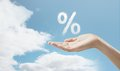 Percentage hand in sky holding Royalty Free Stock Photo