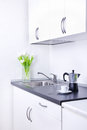 Percolator and cup of coffee on worktop, kitchen interior Stock Images