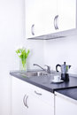 Percolator and cup of coffee on worktop kitchen interior one Stock Photography