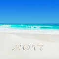 Perect white sand ocean beach and year 2017 season caption