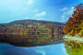 Perfect autumn lake scenery vibrant calm reflecting mountain landscape Stock Image