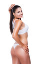 Perfect curves rear view of beautiful young woman with buttocks looking over shoulder and smiling while standing isolated on white Stock Image