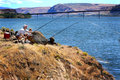 The perfect fishing spot a couple sturgeon with reel and pole in columbia river with maryhill bridge in background Stock Photos