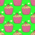 Perfect graphical seamless pattern with detailed drawn cupcakes and icing.