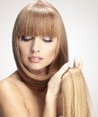 Perfect hair portrait of beautiful girl with long shiny blond studio shot Stock Photo