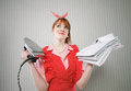 Perfect housewife with iron and ironed shirts Royalty Free Stock Images