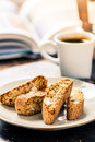 Perfect morning awake, book, espresso and cantucci Royalty Free Stock Photo