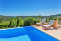 Perfect place to relax with pool sea view a Royalty Free Stock Photos
