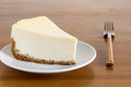 Perfect plain cheesecake on white plate slice of new york wooden background Stock Photos