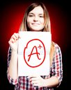Perfect school grade a plus of exam and happy girl woman Royalty Free Stock Photography