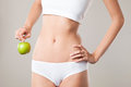 Perfect slim woman body and apple diet concept on grey background Stock Photo