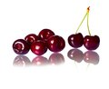 Perfect sweet cherries with leaf on white background Stock Images