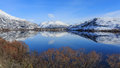 Perfect water surface reflection at lake hayes in winter queenstown new zealand Royalty Free Stock Photos
