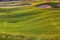 Perfect wavy ground with green grass on a golf field nice Stock Images