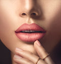 Perfect woman's sensual lips with beige matte lipstick