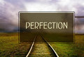 Perfection concept green road sign with a wording dark railroad background Royalty Free Stock Photos
